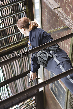 female police sergeant standing with gun