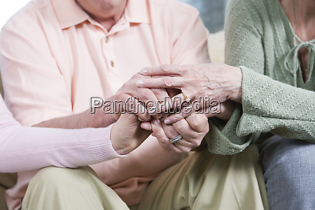view of friends holding hands together