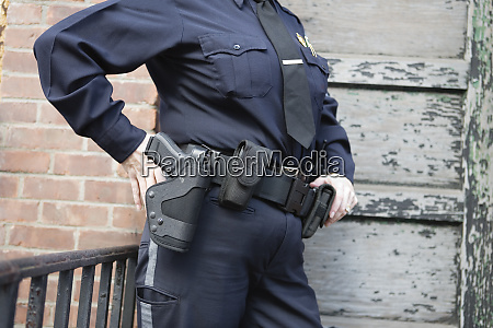 midsection of a female police sergeant