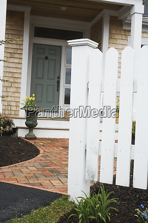 picket fences in front of house