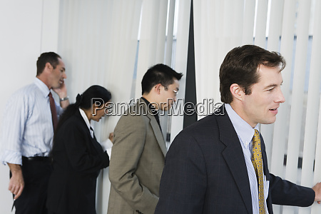 view of businesspeople peeping through windows