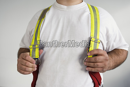 midsection of a man wearing suspenders