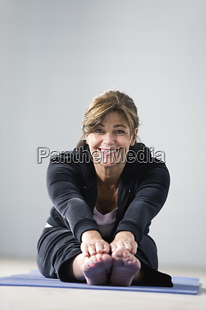 portrait of a mature woman stretching