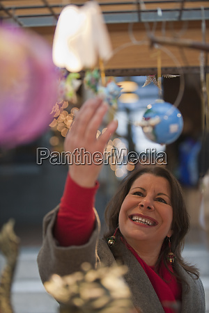 woman looking at christmas decorations in