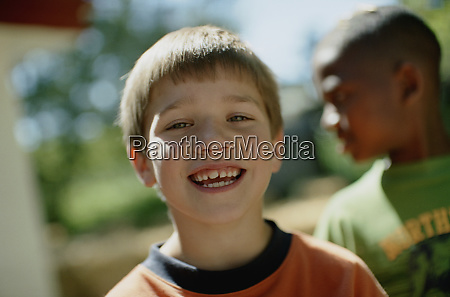 young boy with a big smile