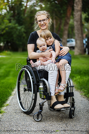 a paraplegic mom carrying her daughters