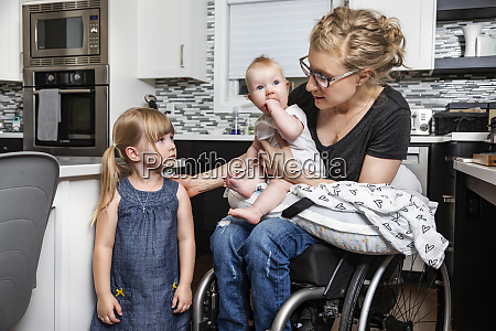 a paraplegic mom in a wheelchair