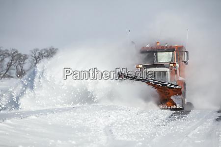 snow plough moving fresh snow sault