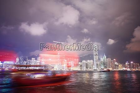 tourist boat and hong kong skyline