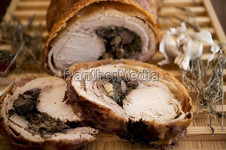 slices of stuffed pork roast