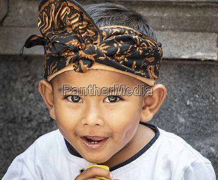 balinese boy at a temple ceremony