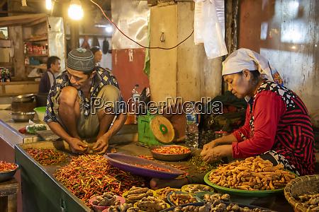 chili pepper vendors at the market