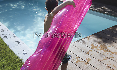 boy with pink inflatable raft at