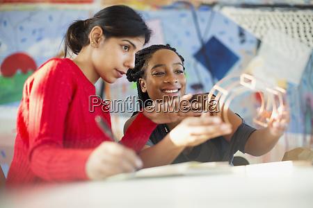 female engineers examining prototype in office