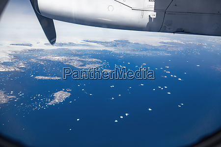 view from propellor airplane of melting