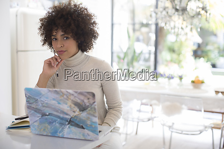portrait confident young female freelancer working