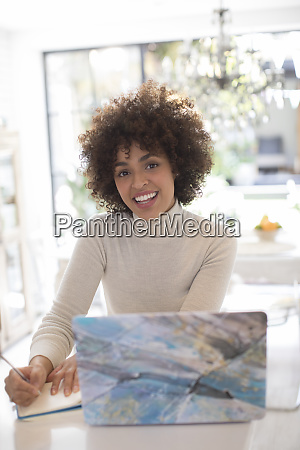 portrait happy young female freelancer working