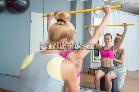 woman in the physical therapy stretching
