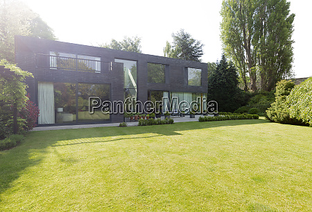 modern house and sunny landscaped yard