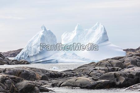 melting iceberg formation among rocks greenland