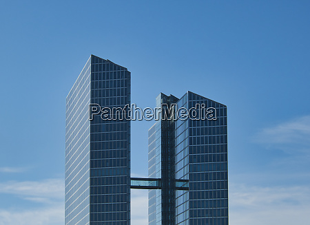 two high rise buildings with connecting