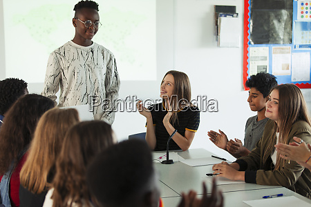high school students clapping for classmate