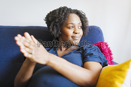 happy pregnant woman rubbing hands together
