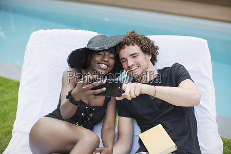 happy young couple taking selfie with