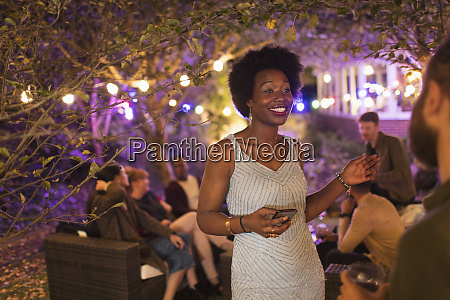 smiling woman with smart phone talking