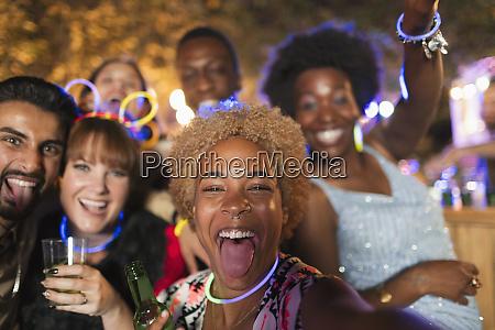 portrait happy exuberant friends cheering at