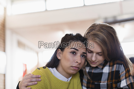 young woman consoling friend