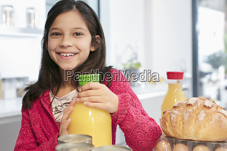 portrait smiling girl with orange juice