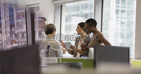 business people with digital tablet talking