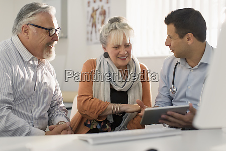 doctor with digital tablet meeting with