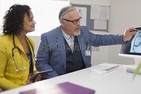 doctors consulting examining digital x ray