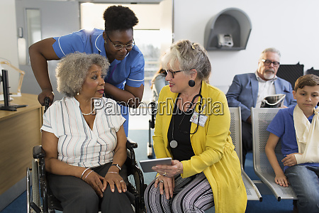 female doctor with digital tablet talking