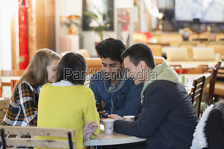 young friends using smart phones at