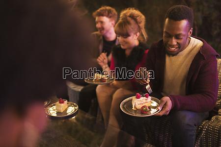friends celebrating birthday eating cake on