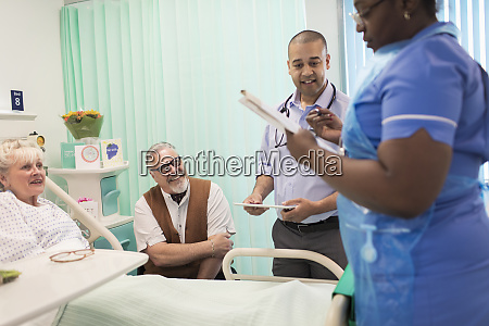 doctor and nurse making rounds talking