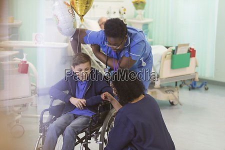 doctor and nurse talking with boy