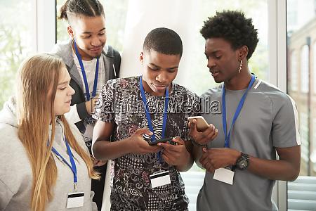 high school students with smart phones