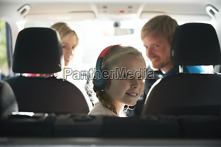 portrait smiling girl with headphones riding