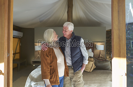 happy senior couple in safari lodge