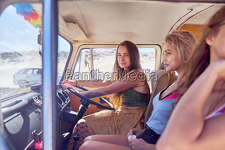 confident young woman driving van