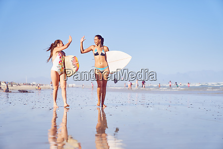 happy young female surfer friends high