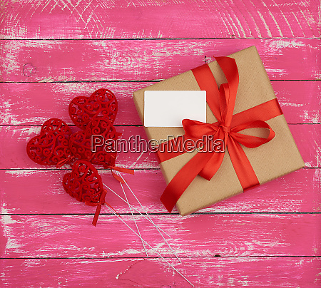 rectangular box with a gift tied