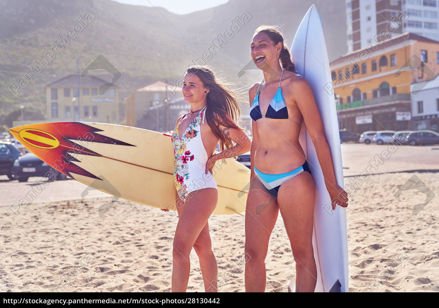happy, young, female, surfers, with, surfboards - 28130442