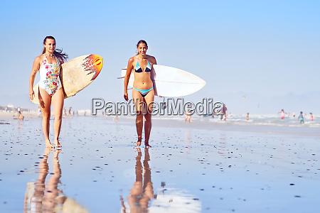 portrait, confident, young, female, surfers, on - 28130284