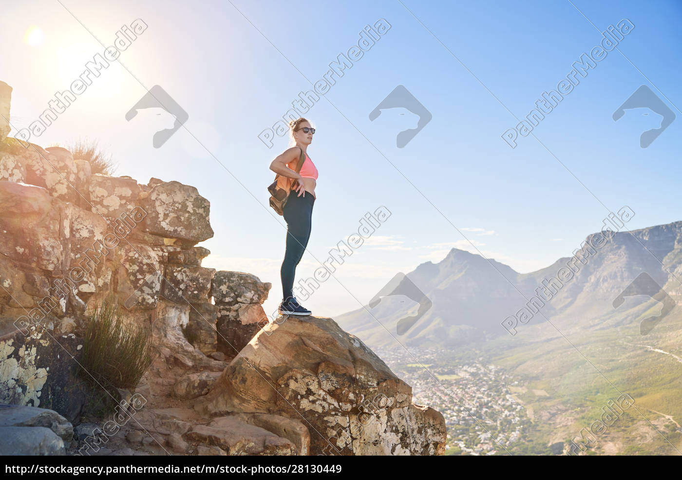 young, female, hiker, on, sunny, cliff - 28130449