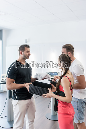 trainer treating woman and man in